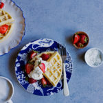 Coconut Oil Waffles | coconut-scented waffles with crisp edges and tender middles, perfect for topping with loads of berries, cream, and a flurry coconut, or a generous pour of maple syrup.